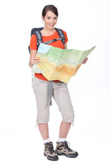 Female backpacker studying a map