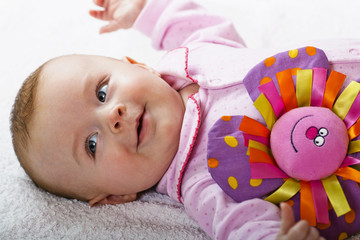 Newborn baby with a toy