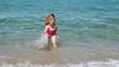 little girl splash water and fun
