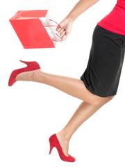 Shopping woman running holding bag