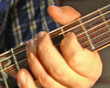 close-up playing at electric guitar