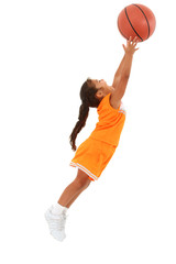 Adorable Girl Child in Uniform Jumping with Basketball