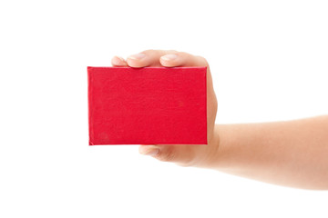Red card in human hand isolated on white background