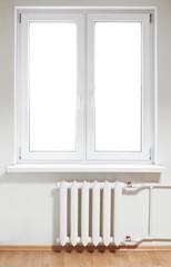 White plastic  window with radiator under. Isolated on white