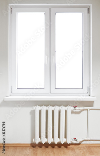 White plastic  window with radiator under. Isolated on white