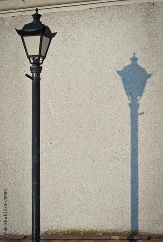 Old fashioned street light with shadow|33579393