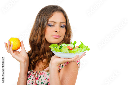 girl holding a plate with salad