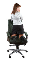 swoman  kneeling on chair
