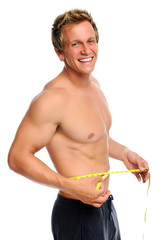 Happy man with measuring tape