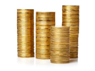 Golden  coin stacks isolated over white