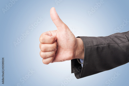 businessman hand make thumbs up