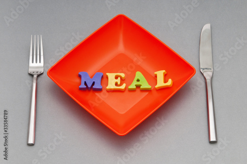 Plate with letters on the white background