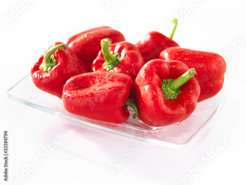 Red sweet pepper on a glass plate
