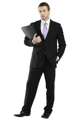 confident young businessman holding portfolio