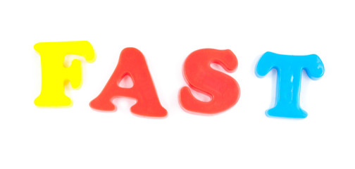 fast written with fridge magnets on white background