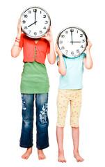Caucasian girls holding clocks