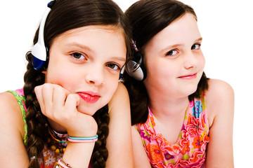 Portrait of girls listening music on headphones