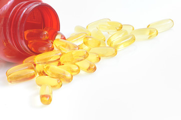 yellow fish oil capsule pile