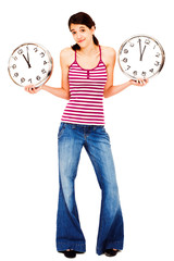 Young woman holding clocks