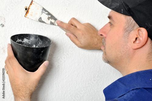 Leinwanddruck Bild Handwerker beim Zuspachteln