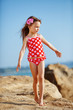 Child at beach in summer