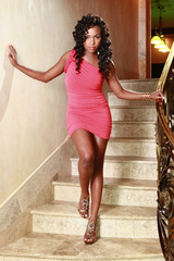 African American poses at a stairway