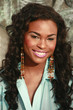 Cute African American in turquoise blouse
