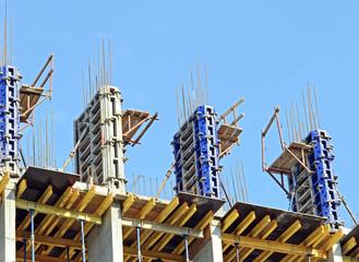 Detail of  building  construction site against blue sky