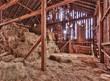 Leinwanddruck Bild - Interior of old barn with straw bales