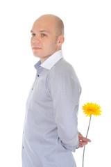 man holding a red flower