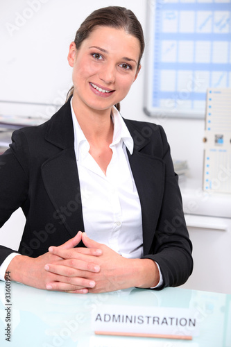 pretty woman working at an administration service
