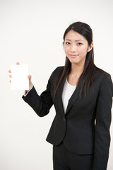 a portrait of asian businesswoman with blank whiteboard