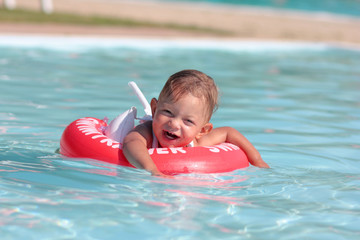 Cute baby in the swimmingpool