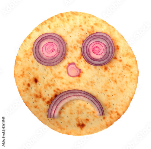 Sad cake face with red onion