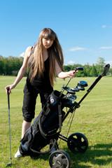 Women stay on green golf field