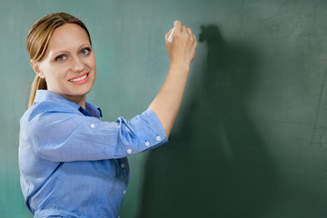 attractive teacher or student at the blackboard