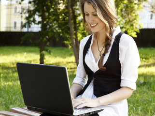 Young pretty woman with laptop