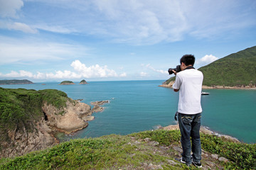 photographer takes a photo of the landscape
