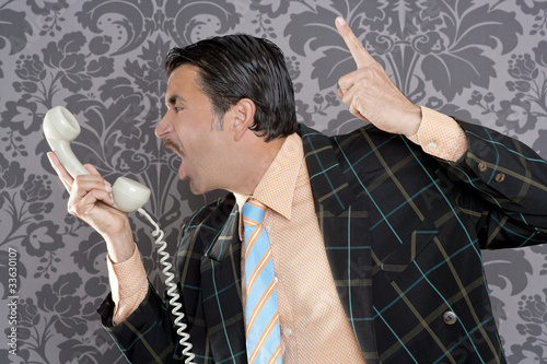 Angry nerd businessman retro telephone call shouting