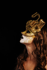 sexy woman in golden party mask