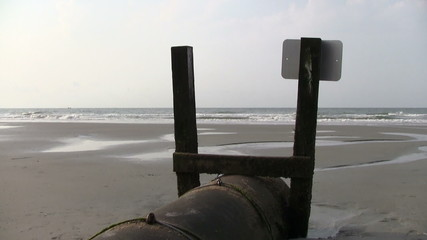 Drain pipe on beach