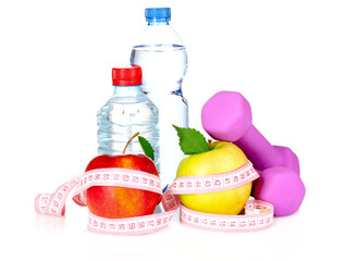 towel, apple with measure tape, dumbbells and water bottle isola