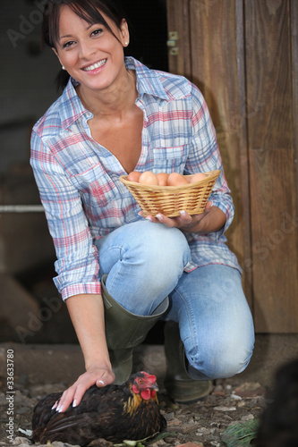 woman picking eggs