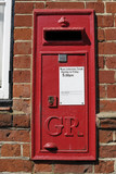 English Red postbox mounted on wall poster