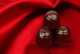 chocolate candy on red satin