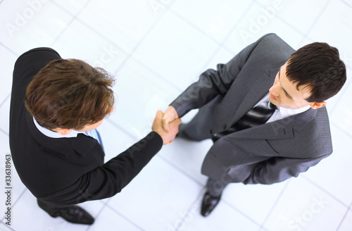 Top view of a two businessman shaking hands -