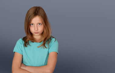 Portrait of young girl with upset look