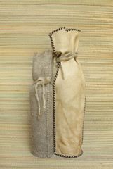 Bottles in gift bags made of leather and burlap