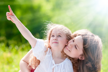 beautiful little girl showing to her mother