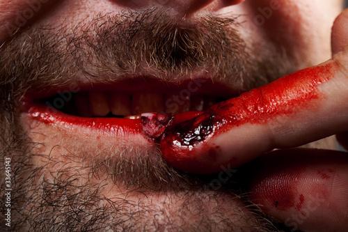 Crazy nailbiter. A man biting of his nails, close up